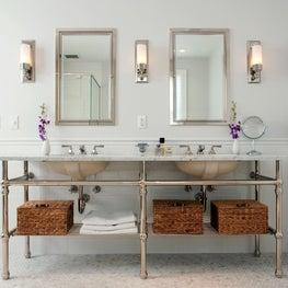 Double console master bath with carrara floor tile