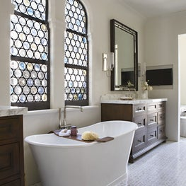 Custom bottle glass windows adds character to this master bathroom