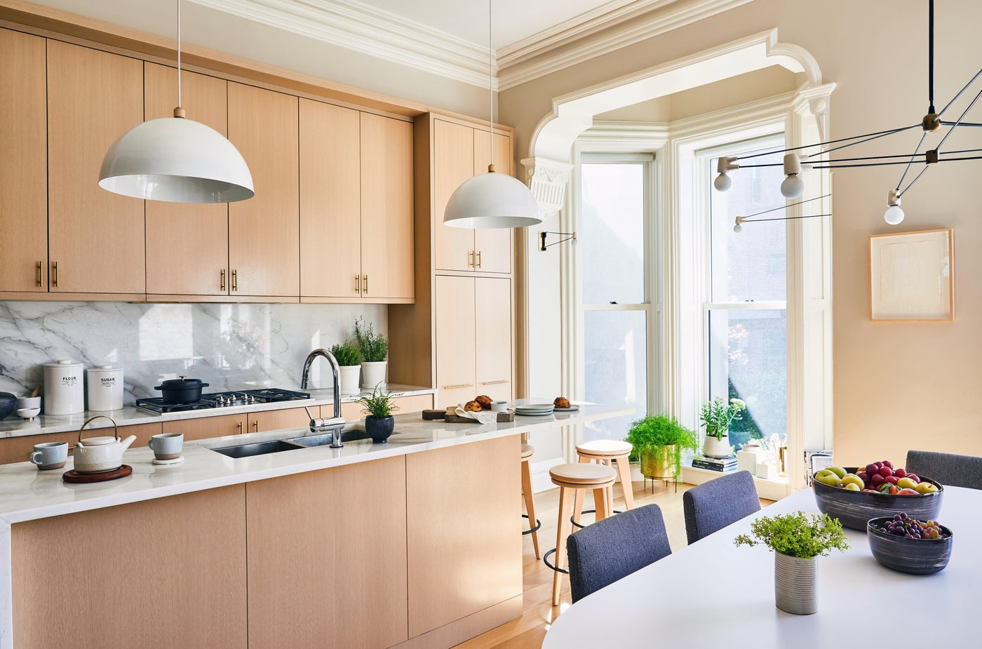 Hudson Street Brownstone I Kitchen | Cerused Cabinets | Marble Counters