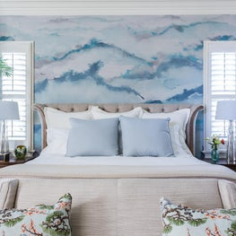Colorful Wallpaper Accent Wall and Light Neutral Bed Linens Paired w/ Soft Blues