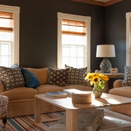 Family Room in a beach house. Dark walls and soft beiges make a cozy room.