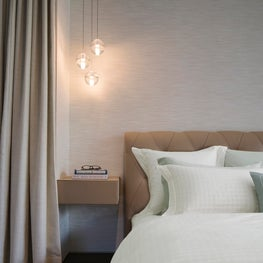 Millenial House, Master bedroom, leather night table, suspended night table lamp and leather headboard