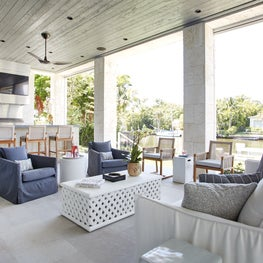 Outdoor terrace w/ tongue & groove ceiling, roller shades, & summer kitchen.