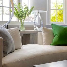 Contemporary split-back sofa showcasing a custom wood/metal custom console