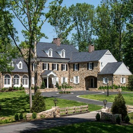 Colonial Revival Stone Farmhouse with porte cochere in Montgomery County, PA