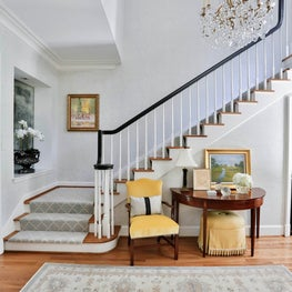 Traditional entry hall & stairway with a soft neutral & yellow palette