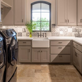 Who says a laundry room can't be luxurious?  Beautiful built in storage