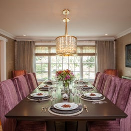 Vivid colors and modern influences make an impact on a transitional dining room.