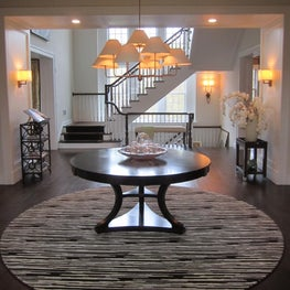 The entrance foyer in this Chappaqua, NY residence is harmonious and inviting.
