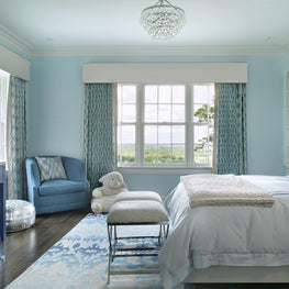 Girls Bedroom with aqua accents and wallpapered headboard wall
