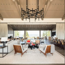 Double height Napa great room with retractable glass wall, custom Groves & Co. chandelier over vintage and bespoke furniture