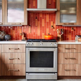 70's Inspired kitchen - Bold back splash grounded by walnut cabinetry