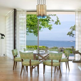 Green and blue dining room with water views