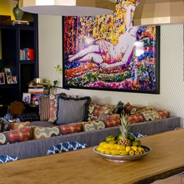 Rua Turquia Dining and family room with colorful art and pillows