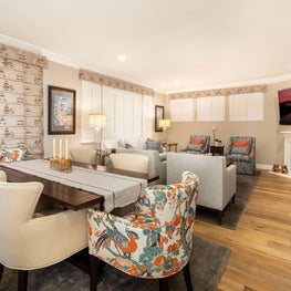 Bold patterns, dining table and reupholstered dining chairs, and window treatments