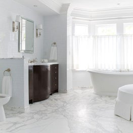 Marble tile gives the expansive master bath a spa-like feel.