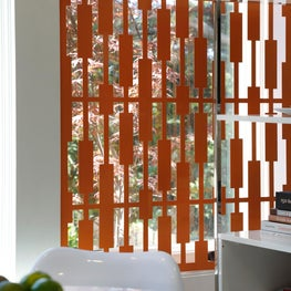 Custom laser cut metal window panel in custom made to match orange finish