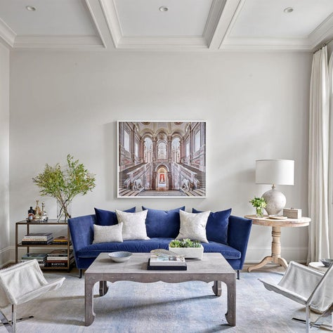 Living Room, Blue Montauk Sofa, David Burdeny Art, Ironies Design Coffee Table, Oscar Isberian Rug, Cream Walls, Cream Curtains - Lincoln Park Greystone Project