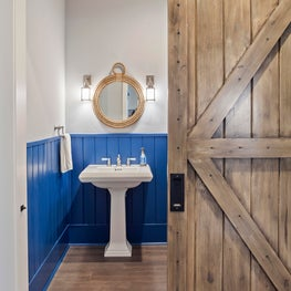 Nautical powder room with stunning barndoor