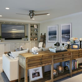 The custom built-in TV unit in this neutral living room creates a relaxing space