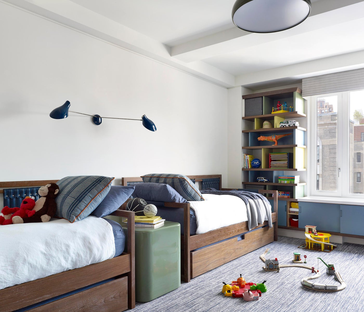 Mid-century inspired kid's bedroom with custom lacquer end table and lighting
