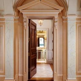 Pedimented entry to a Powder Room.  Burl walnut flooring and door.
