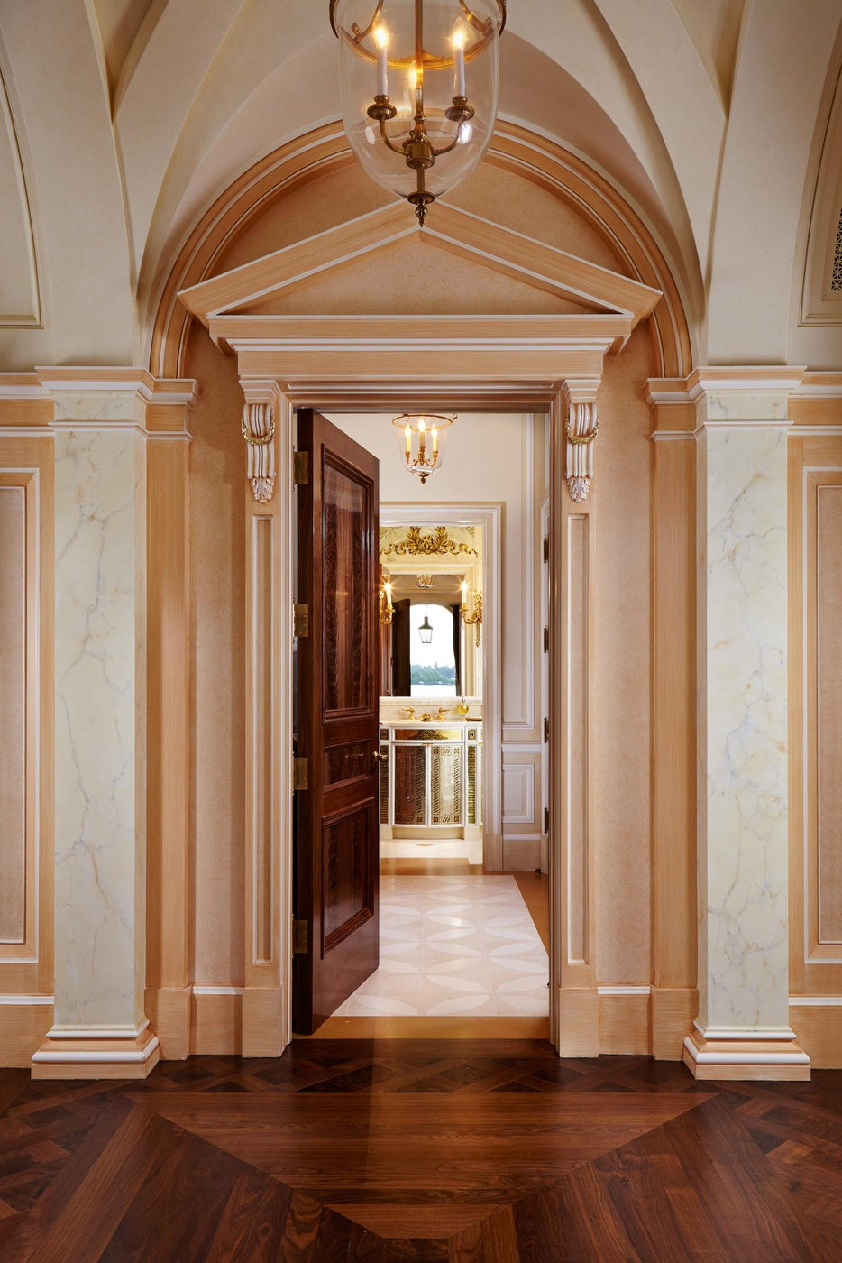 Pedimented entry to a Powder Room.  Burl walnut flooring and door.