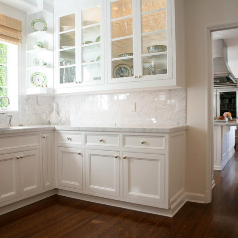 Butlers Pantry with white marble, wood floors and displaying Hermes China