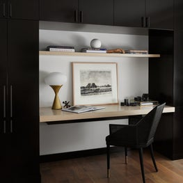 Built-in desk with white oak work surface and Baker desk chair