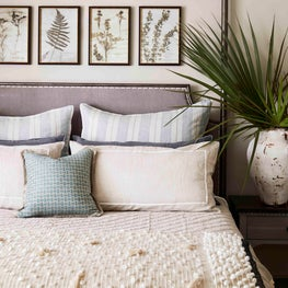 Organic motifs and textures make this neutral bedroom so inviting