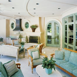 Outdoor loggia designed for entertaining draws its color scheme from the pool