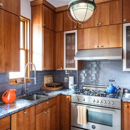 Compact Kitchen with Blue Bahia Granite, glass tile backsplash, lantern fixture.