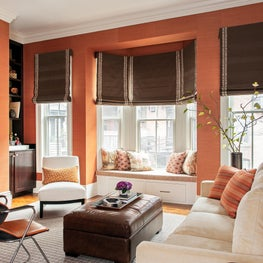 family room window seat leather storage leather ottoman grasscloth roman shades