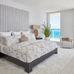Palm Beach Oceanside Sophistication Master Bedroom with modern shag white area rug.