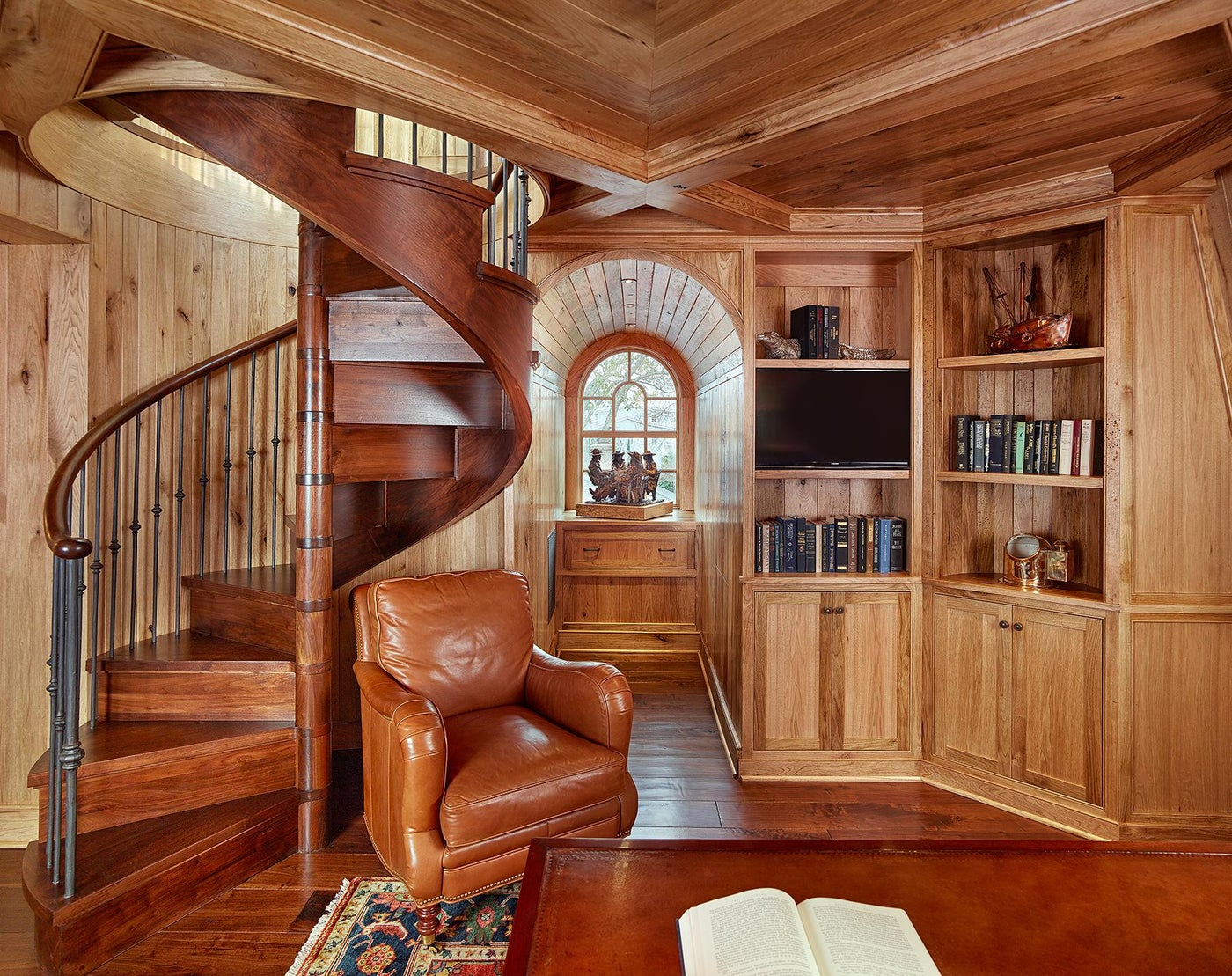 Butternut Wood Paneled Library with Wood Spiral Stair and Arched Window
