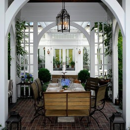 An outdoor dining pavilion and English-styled greenhouse for al fresco dining.