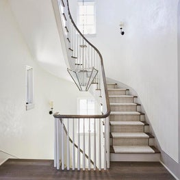 White plaster walls with gray trim seaside Stairwell