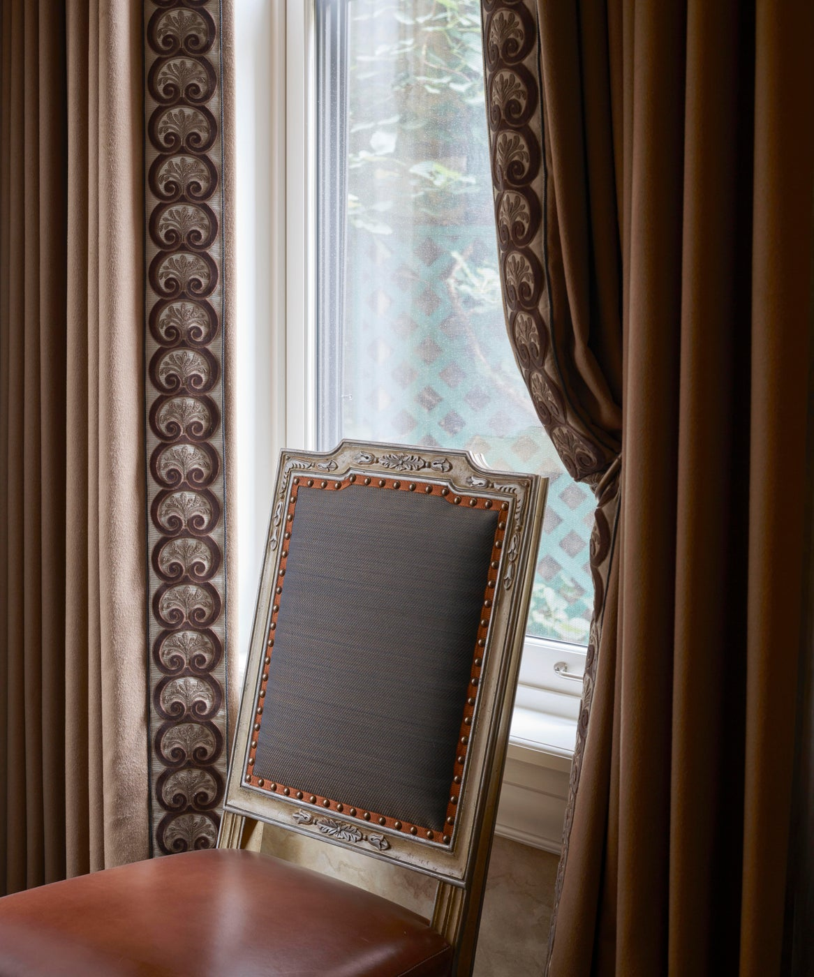 Drapery and chair detail showing exquisite trims and detailing.