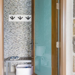 Pool bath in contemporary-style home featuring pebbled walls and TruStile door