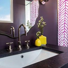 Bathroom featuring moody purple wall color
