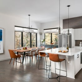Modern open concept kitchen and dining with camel accents - Atlanta GA