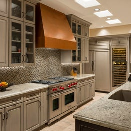 Transitional kitchen with copper hood and glass mosaic backsplash, Scottsdale