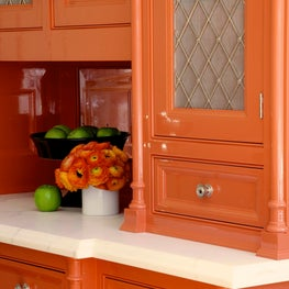 Bright orange cabinetry by Christopher Peacock Cabinetry