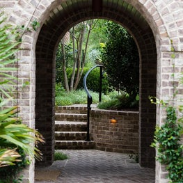 Brick Arched Exterior Breezeway and Landscape Brick Steps