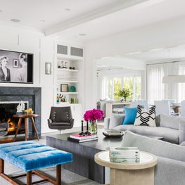 Transitional Living Room, Paneled Walls, Turquoise Accents, Modern Stone Mantle