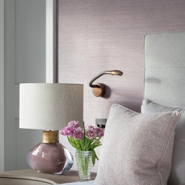 Master bedroom featuring textured grasscloth wallcovering, serene colours