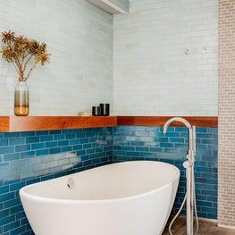 Freestanding Bathtub on Stone Floor