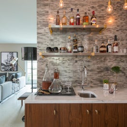 Wet Bar with Gold Chain Light Fixture and Custom Cabinetry
