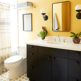 Moroccan style full bathroom with geometric pattern tile and vanity cabinet