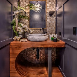 Powder Room grid walls, tile mosaic, a blend of contemporary and old fixtures.